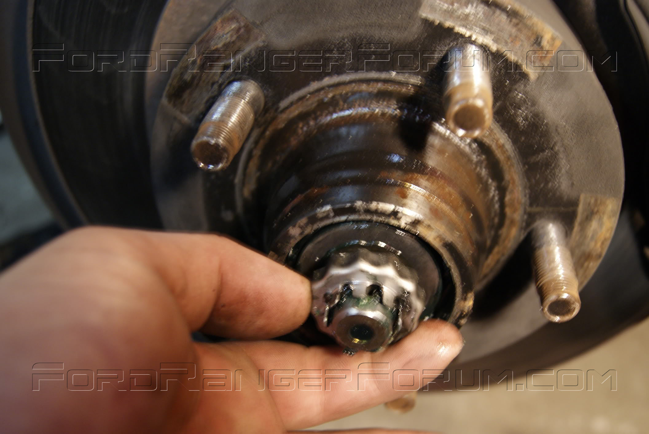 service manual  how to change front wheel bearing 2001