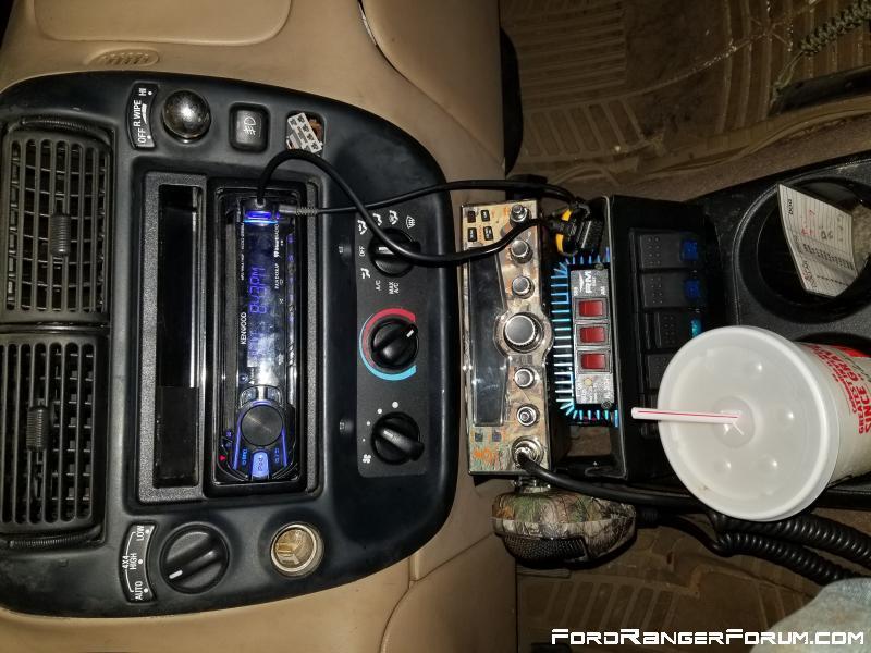 Explorer radio bezel, cobra 29 lx radio, 100w amp, and five switches for misc.